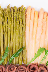 Closeup of asparagus salad with anchovies.