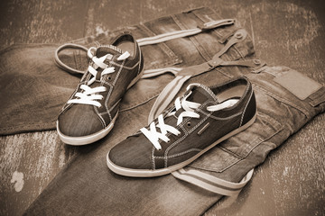 fashionable sneakers and jeans, photo toning in sepia
