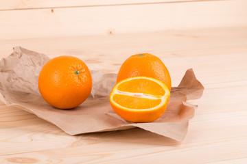 Tasty italian oranges on wood table.