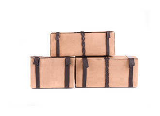 Stack of gift carton with leather laces.
