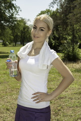 attractive woman holding a bottle of water