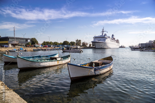 Fishing boats and passenger ship
