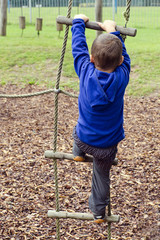 Child climbing ladder at playground