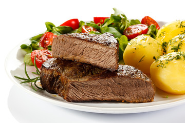 Beefsteak, boiled potatoes and vegetables