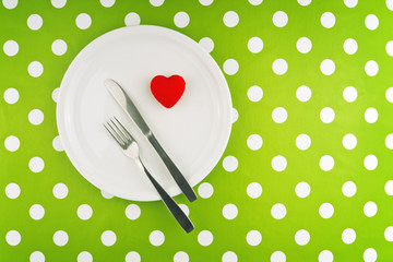 Red heart served on white plate