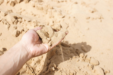 Sand strewing from hand