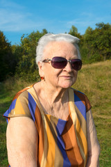 Old woman in sunglasses