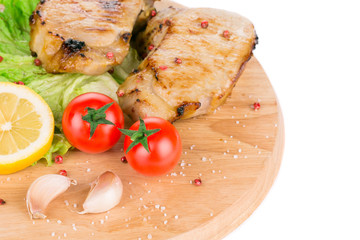 Grilled pork with vegetables.