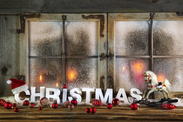 Weihnachtskarte mit Text Christmas oder Hintergrund mit Kerzen