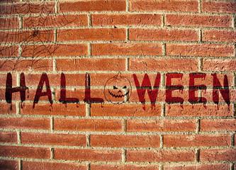 Halloween text on brick wall