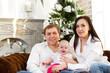 Happy smiling family near the Christmas tree