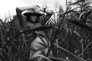 safari woman in swamp black and white
