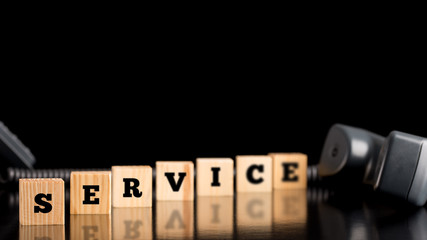 The word Service on wooden blocks