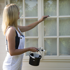 Painter decorator painting windows