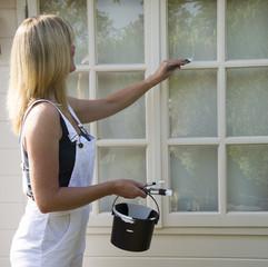 Painter decorator painting windows