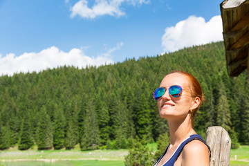 Woman with sunglasses in forest