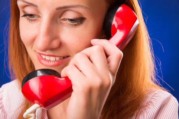 Redhead woman with red telephone