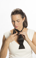 Tying a black formal bow tie