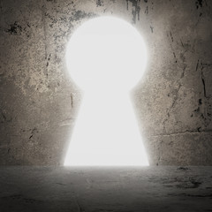 In concrete wall doorway as keyhole. Bright light