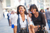 Fototapety Two Beautiful Black Woman Walking in New York
