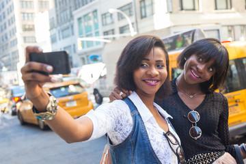 Two Beautiful Black Woman taking Selfie in New York