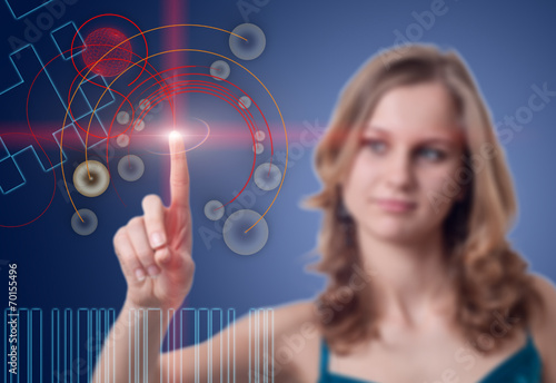 canvas print picture Young woman presses the button on the high-tech screen