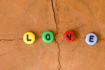 Colored love on wooden background