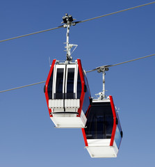 Two gondola lifts close-up view