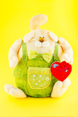 Soft toy. The dog dressed coveralls