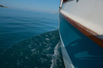 Water wake behind yacht