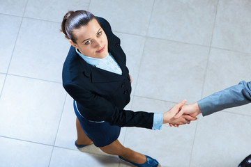 Portrait of a businesswoman shaking hand
