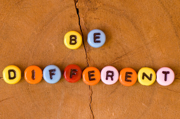 Colored be different on wooden background