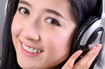 Asian woman teenager listing for relaxation with Headphone