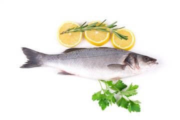 Fresh seabass with lemon on plate.