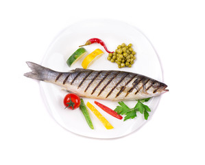 Grilled seabass with vegetables on plate.