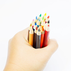Color pencil in hand on white background