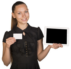 Beautiful girl in dress holding blank white card and tablet