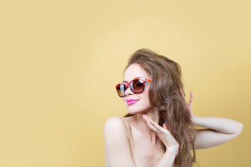 Portrait of a pretty enthusiastic woman in sunglasses