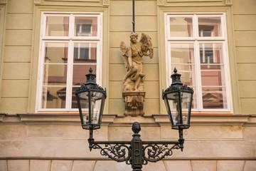 sculpture and street lighter in Prague