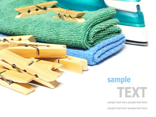 Wooden clothes pin and iron laundered fabric isolated on white b