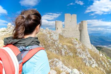 Girl looks the Rocca Calascio Castle, Abruzzo, Italy