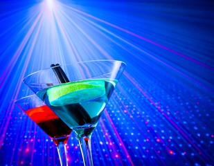 cocktail with blue light disco background with space for text