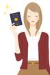 canvas print picture - パスポートを持った笑顔の女性