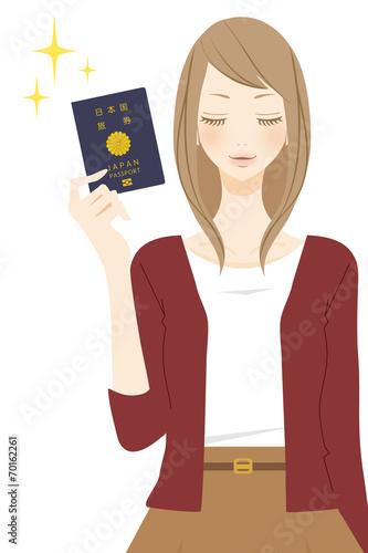 canvas print picture パスポートを持った笑顔の女性