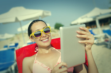 Woman with tablet pc at the beach