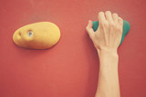 Hand on bouldering wall