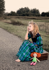 Crying girl sitting on the street