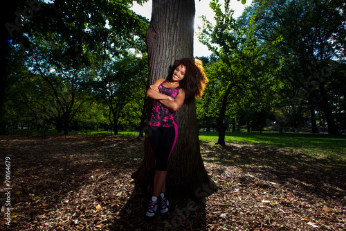 Young Brunette Hispanic woman working out in Central Park Poster