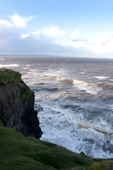 cliff edge and storm waves