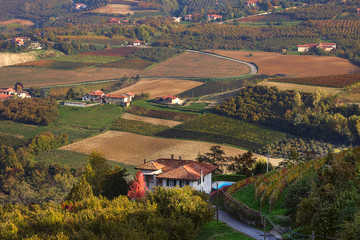 Rural house and autumnal fields in Italy.
